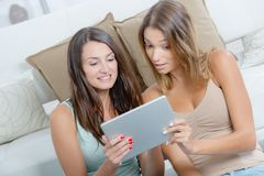 Girl friends sharing information from internet royalty free stock photography