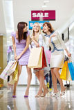 Girl-friends in shop Royalty Free Stock Photo