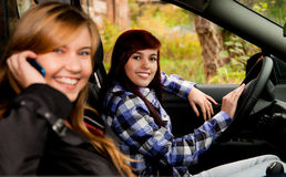 Girl friends sitting in the car Royalty Free Stock Photography