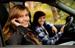 Girl friends sitting in the car Royalty Free Stock Images