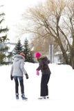 Girl friends skating Royalty Free Stock Image