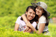 Girl friends smiling together Stock Images