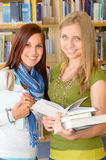 Girl friends student at high school library Stock Images