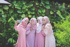 Girl friends taking selfie Stock Photography