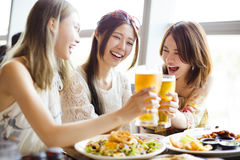 Girl friends toasting and eating in the  restaura Royalty Free Stock Photo