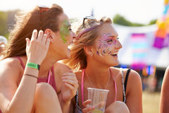 Girl friends wearing face paint at music festival, close up Royalty Free Stock Photography