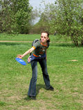 Girl with frisbee. Disc going to throw stock photography