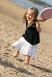 Girl and frisbee on a beach. Taken in Ireland -  Malahide beach. Girl is 3 years old Royalty Free Stock Photos