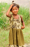Girl with frock. Poor needy Indian child with showing her printed frock Stock Image