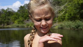 Girl with Frog stock video