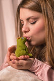 The girl and the Frog royalty free stock photography