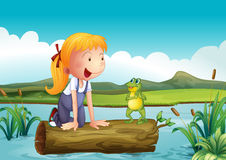 A girl with a frog in the river Royalty Free Stock Photography