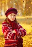 Girl in front of autumn leaves royalty free stock photos