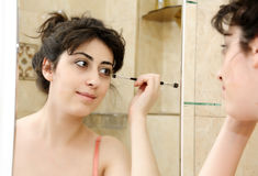 Girl in front of bathroom mirror Stock Image