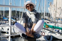 The girl in front of the bay with yachts Royalty Free Stock Photo