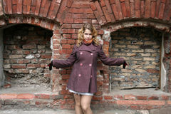 A girl in front of brick recesses Royalty Free Stock Images