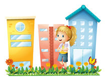 A girl in front of the buildings with a garden Royalty Free Stock Photography