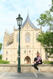 Girl in front of Cathedral of St. Barbara Royalty Free Stock Images