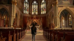 Girl in Front of Church Alter Stock Photography