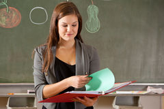 Girl in front of classroom Stock Image