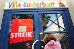 Girl in front of closed kindergarten because of strike Stock Image