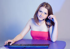 The girl in front of computer Royalty Free Stock Image