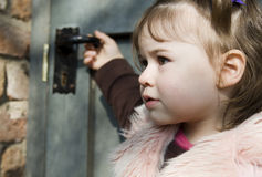 Girl in front of a door Royalty Free Stock Images