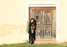 Girl in front of door Royalty Free Stock Image