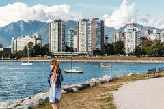 Girl in front of Downtown Vancouver, Canada Stock Images