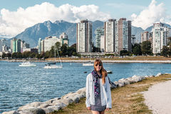 Girl in front of Downtown Vancouver, Canada royalty free stock image