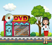 A girl in front of the dvd store Royalty Free Stock Photo