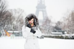 Girl in front of the Eiffel tower on a winter day Royalty Free Stock Image