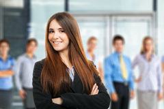 Girl in front of a group of people Royalty Free Stock Image