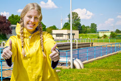 Girl in front of a purification plant Royalty Free Stock Image