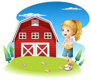 A girl in front of the red barnhouse in the hilltop Stock Photography