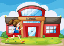 A girl in front of the school building Stock Images
