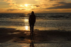 Girl in front of sea sunset Stock Images