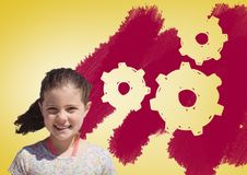 Girl in front of settings gear cogs Royalty Free Stock Images