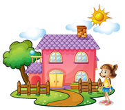A girl in front of their house Stock Image