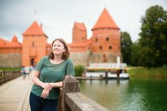 Girl in front of Trakai Castle Royalty Free Stock Images
