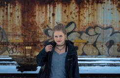 Girl in front of wall of graffiti Royalty Free Stock Photo