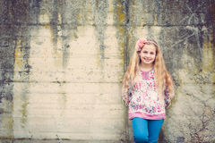 Girl in front of a wall Stock Photography