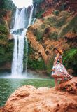 Girl In Front Of A Waterfall royalty free stock photos