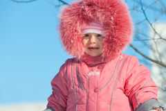 Girl in front of winter sky Stock Image