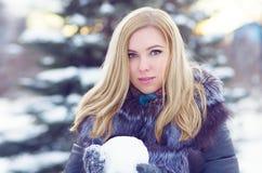 Girl in frost. In a winter sheepskin coat Stock Photos