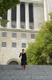 Girl in a frotn of a courthouse2 Royalty Free Stock Image