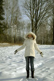 Girl frowing snow Stock Photo
