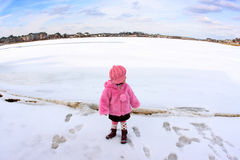 Girl on a frozen lake. Girl walking and enjoying the view of a frozen lake Royalty Free Stock Photo