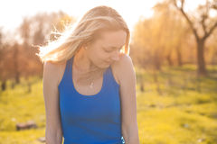 Girl frozen in the rays of the sun and shivering Stock Photos