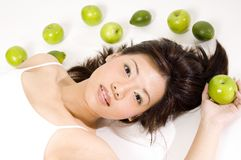 Girl With Fruit 10. A cute young asian woman holding an apple on a white background Royalty Free Stock Images